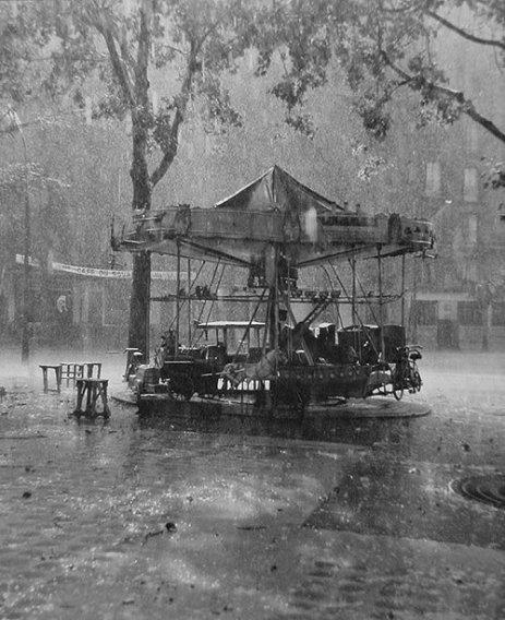 Doisneau Le Manege de Monsieur Barre rain